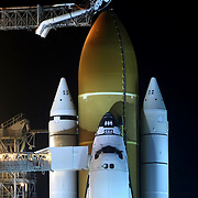 Space shuttle Discovery stands ready for launch at Pad 39A as the rotating service structure is moved back to expose the orbiter at the Kennedy Space Center in Cape Canaveral, Fla., Wednesday, Feb. 23, 2011. (AP Photo/Alex Menendez)