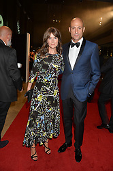 MARK STRONG and LIZA MARSHALL at the GQ Men of The Year Awards 2016 in association with Hugo Boss held at Tate Modern, London on 6th September 2016.