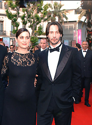 ©Arnal-Hahn-Nebinger/ABACA. 45645-18. Cannes-France, 15/05/2003. Cast members Hugo Weaving, Carrie-Anne Moss and Keanu Reeves arrive at the screening of the film Matrix Reloaded in the Palais des Festivals as part of the 56th Cannes Film Festival.  Cannes Film Festival Festival de Cannes Festival du Film de Cannes Cannes Film Festival Matrix Reloaded Matrix 2 The Matrix Reloaded Moss Carrie-Anne Moss Carrie-Anne Reeves Keanu Reeves Keanu Weaving Hugo Weaving Hugo Montee des marches Tapis rouge Red carpet Presentation de film Presentation de serie Movie Screening<br />