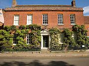 Frontage of red brick Georgian house, Dedham, Essex, England