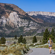 A jogger on the Mammoth Lakes Town Loop path with a view of Mammoth Rock.