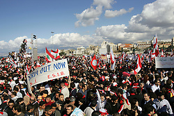 Several thousand Lebanese gather at the scene of the bombing that killed former Prime Minister Rafik Hariri, Beirut, Lebanon, Feb. 21, 2005. The crowd demanded a Syrian pullout and an international probe into the assassination.