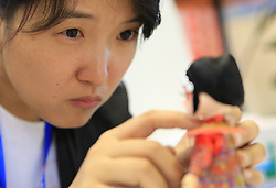 September 4, 2017 - Guilin, Guilin, China - Guilin, CHINA-4th September 2017:(EDITORIAL USE ONLY. CHINA OUT) ..A folk artist makes silk figurines at an international expo in Guilin, southwest China's Guangxi, September 4th, 2017. (Credit Image: © SIPA Asia via ZUMA Wire)