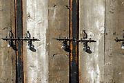 Bare wooden shop front shutters with bolts and padlocks. Thimphu,Thimpu, Bhutan. Druk Yul 13 November 2007