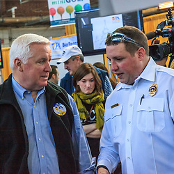 Harrisburg, PA, USA - January 5, 2013: Pennsylvania Governor Tom Corbett speaks with a dog warden at the PA Farm Show.