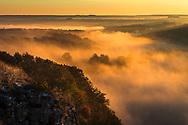 Clouds above a river at sunrise