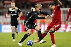 (l-r) Kasper Dolberg of Ajax, Javi Martinez of FC Bayern Munchen during the UEFA Champions League group E match between Bayern Munich and Ajax Amsterdam at the Allianz Arena on October 02, 2018 in Munich, Germany