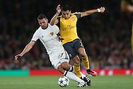 Alexis Sanchez of Arsenal (r) intercepts Marek Suchy of FC Basel. UEFA Champions league group A match, Arsenal v FC Basel at the Emirates Stadium in London on Wednesday 28th September 2016.<br /> pic by John Patrick Fletcher, Andrew Orchard sports photography.