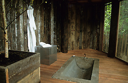 Decked outside room with concrete bath