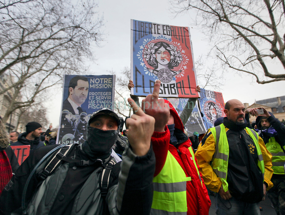 19 January 2019. Paris, France.<br /> Gilets Jaunes - Acte X take to the streets of Paris. Flicking the bird to the media. An estimated 7,000 people took part in the looping 14 km route from Place des Invalides to protest tax hikes from the Government of Emmanuel Macron imposed on the people. An estimated 80,000 people took part in protests across the country. Regrettably the movement has attracted a violent element of agitators who often face off with riot police at the end of the marches which tends to deflect attention away from the message of the vast majority of peaceful protesters.<br /> Photo©; Charlie Varley/varleypix.com