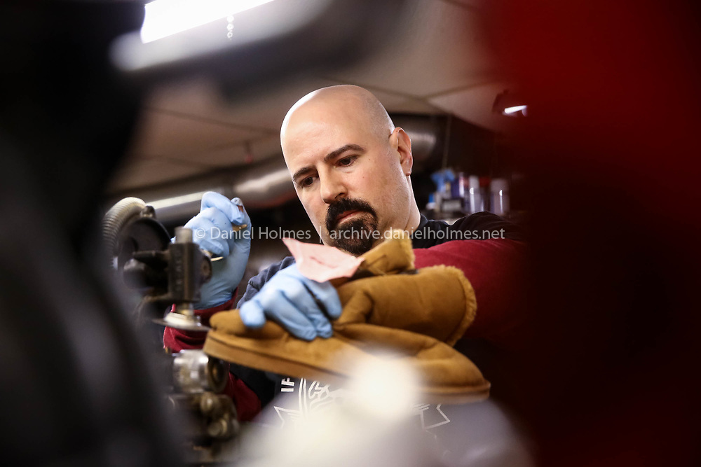 (3/17/17, HOLLISTON, MA) John Elhilow Jr. repairs a shoe at John's Superior Shoe & Boot Repair in Holliston on Friday. Elhilow now owns and operates the shop in Holliston that his father once ran, and also owns a shop in Waltham called Superior Shoe Repair. [Daily News and Wicked Local Photo/Dan Holmes]