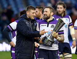 Scotland's Finn Russell (left) and John Barclay (right) celebrate with the Auld Alliance Trophy after the final whistle during the NatWest 6 Nations match at BT Murrayfield, Edinburgh.