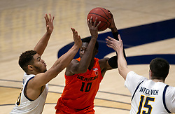 Feb 25, 2021; Berkeley, California, USA; California Golden Bears defenders Matt Bradley (20) and Grant Anticevich (15) double-team Oregon State Beavers forward Warith Alatishe (10) during the first half of an NCAA college basketball game at Haas Pavilion. Mandatory Credit: D. Ross Cameron-USA TODAY Sports