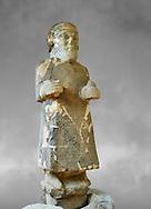 Pictures & images of the South Gate Hittite sculpture statue of Hittite Storm God Tarhunzas ( Tarḫunz Tarḫunna or in Hurrian Teshub or in Phoenician Baal Krntrys ). 8th century BC. Karatepe Aslantas Open-Air Museum (Karatepe-Aslantaş Açık Hava Müzesi), Osmaniye Province, Turkey. Against grey art background