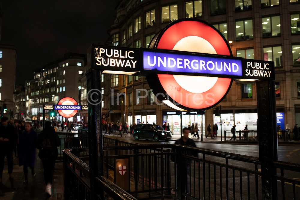 The London Underground subway outside the entrance to Bank underground station on 27th November 2019 in London, England, United Kingdom. The London Underground is a public rapid transit system serving Greater London. The Underground has its origins in the Metropolitan Railway, the worlds first underground passenger railway.