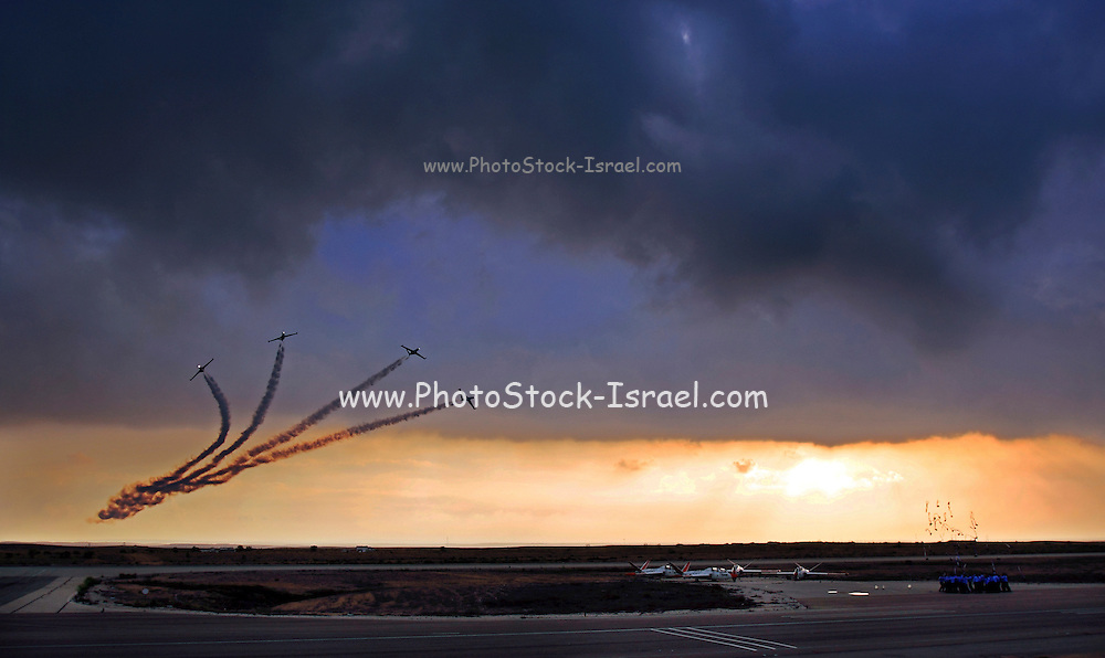 Israeli Air force (IAF) Fouga Magister CM-170 in aerobatics display at sunset