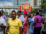 "23 SEPTEMBER 2018 - BANGKOK, THAILAND: The Ganesha procession in Bangkok. Ganesha Chaturthi also known as Vinayaka Chaturthi, is the Hindu festival celebrated on the day of the re-birth of Lord Ganesha, the son of Shiva and Parvati. The festival, also known as Ganeshotsav (""festival of Ganesha"") is observed in the Hindu calendar month of Bhaadrapada, starting on the the fourth day of the waxing moon. The festival lasts for 10 days, ending on the fourteenth day of the waxing moon. Outside India, it is celebrated widely in Nepal and by Hindus in the United States, Canada, Mauritius, Singapore, Thailand, Cambodia, and Burma.    PHOTO BY JACK KURTZ"