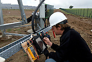 Doug Felmann, Powerlight Operations and Maintenance Manager checks system connections before proceeding with electrical testing.