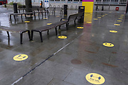 Yellow social distancing stickers remain on the pavement outside the London College of Cummincation (LCC) during the third lockdown of the Coronavirus pandemic, at Elephant & Castle, on 20th January 2021, in London, England. Universities are still closed to students, with lectures continuing online after the Christmas break accordng to government restrictions, helping to reduce infection rates in the capital at a time when the UK has the highest death rates per 100,000.