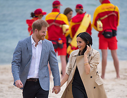 The Duke and Duchess of Sussex meet lifeguards as they walk on South Melbourne Beach during their visit to Melbourne, on the third day of the royal couple's visit to Australia.