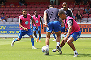 AFC Wimbledon striker Kweshi Appiah (9) warming up during the Pre-Season Friendly match between AFC Wimbledon and Queens Park Rangers at the Cherry Red Records Stadium, Kingston, England on 14 July 2018. Picture by Matthew Redman.