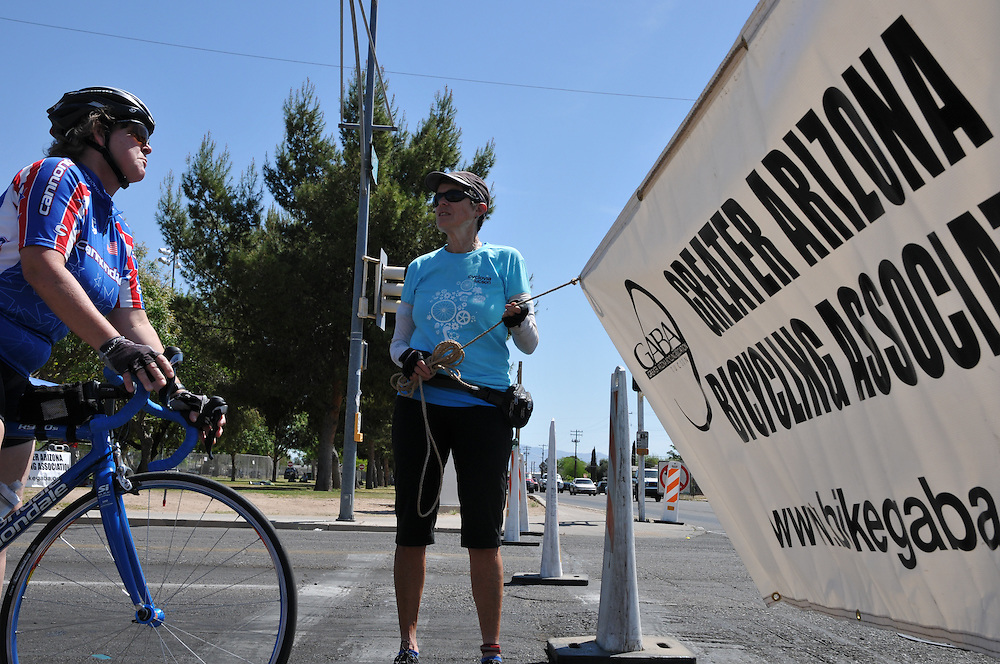 Cyclovia 2013 rider pauses at the Greater Arizona Bicycling Association banner at 4th Avenue and 22nd Street. Bike-tography by Martha Retallick.