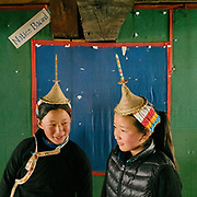 "Every other day, Layap girl are asked to wear the traditional Layap outfit, including the conical bamboo hat. On other days, they must wear the ""kira"" the national dress. Visiting the only school in Laya village."