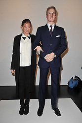 ELIZABETH VON GUTTMAN with a statue of Prince William at a private view of 'Engagement' an exhibition of new works by Jennifer Rubell held at the Stephen Friedman Gallery, 25-28 Old Burlington Street, London on 7th February 2011.