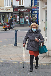 © Licensed to London News Pictures 28/04/2021. Whitstable, UK. A shopper with a mask on. People in Whitstable High Street in Kent wearing masks to protective themselves against the threat of Coronavirus. Photo credit:Grant Falvey/LNP