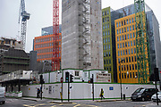 New high rise construction site just behind the Google office headquarters on 3rd March 2021 in London, England, United Kingdom. Google is an American multinational technology company specializing in Internet-related services and products.
