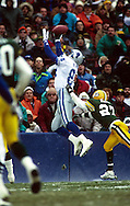 MILWAUKEE, WI-UNDATED:  NFL receiver Herman Moore of the Detroit Lions makes a spectacular catch during a game against the Green Bay Packers at County Stadium in Milwaukee, Wisconsin.   Moore played for the Lions from  1991-2001.  (Photo by Ron Vesely)