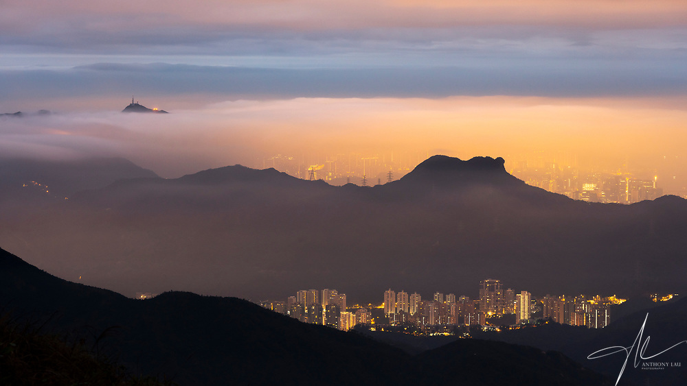 Right before dawn, a sea of cloud covered the iconic Lion Rock in Hong Kong, creating  an unreal layer of light and color.
