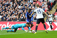 Tottenham goalkeeper Hugo Lloris (on ground) spills the ball under pressure from Chelsea's Michy Batshuayi (c). The Emirates FA Cup semi-final match, Chelsea v Tottenham Hotspur at Wembley Stadium in London on Saturday 22nd April 2017.<br /> pic by Carl Robertson,  Andrew Orchard sports photography.