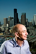 Jeff Bezos, CEO of Amazon.com. Shot in Amazon.com offices, Seattle WA Portrait of Jeff Bezos, CEO of Amazon.com. Photographed at Amazon.com offices in Seattle, WA. Blue sky background.