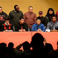 020514  Adron Gardner/Independent<br /> <br /> Surrounded by their parents, Grants Pirate football players Jacob Wilcox, left, Brandon Brito, Raul Enriquez, Tristan Bustos and Cassius Corley present their post-high school plans at the Grants Performing Arts Center in Grants Wednesday.  Wilcox has been looking at three different schools.  Brito, Enriquez and Bustos will all be signing to play football at the College of the Redwoods.  Corley signed to play football at New Mexico State University.<br /> <br /> <br /> <br /> <br /> <br /> nmsu<br /> Cassius Corley