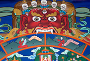 Detail of a painting in traditional Bhutanese style of a buddhist wheel of life in the grasp of the Monster of Impermanance. The painting is illustrates Buddhist teachings and is full of Buddhist symbolism.  Paro Dzong, Druk Yul,  Bhutan. 10 November 2007