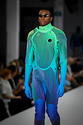 © Licensed to London News Pictures. 06/06/2018. LONDON, UK.  A model presents a look by Martha Kazmierczak from Edinburgh College of Art at the Best of Graduate Fashion Week 2018 show at the Old Truman Brewery in East London. The event presents the graduation show of up and coming fashion designers from UK and international universities.  Photo credit: Stephen Chung/LNP