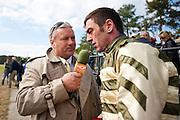 Colonial Cup - Camden, South Carolina. Jimmy Duggan talks with jockey Brian Crowley.