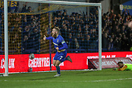 AFC Wimbledon midfielder Scott Wagstaff (7) celebrating after scoring goal to make it 3-0 with West Ham United goalkeeper Adrian (13) looking at goalduring the The FA Cup match between AFC Wimbledon and West Ham United at the Cherry Red Records Stadium, Kingston, England on 26 January 2019.