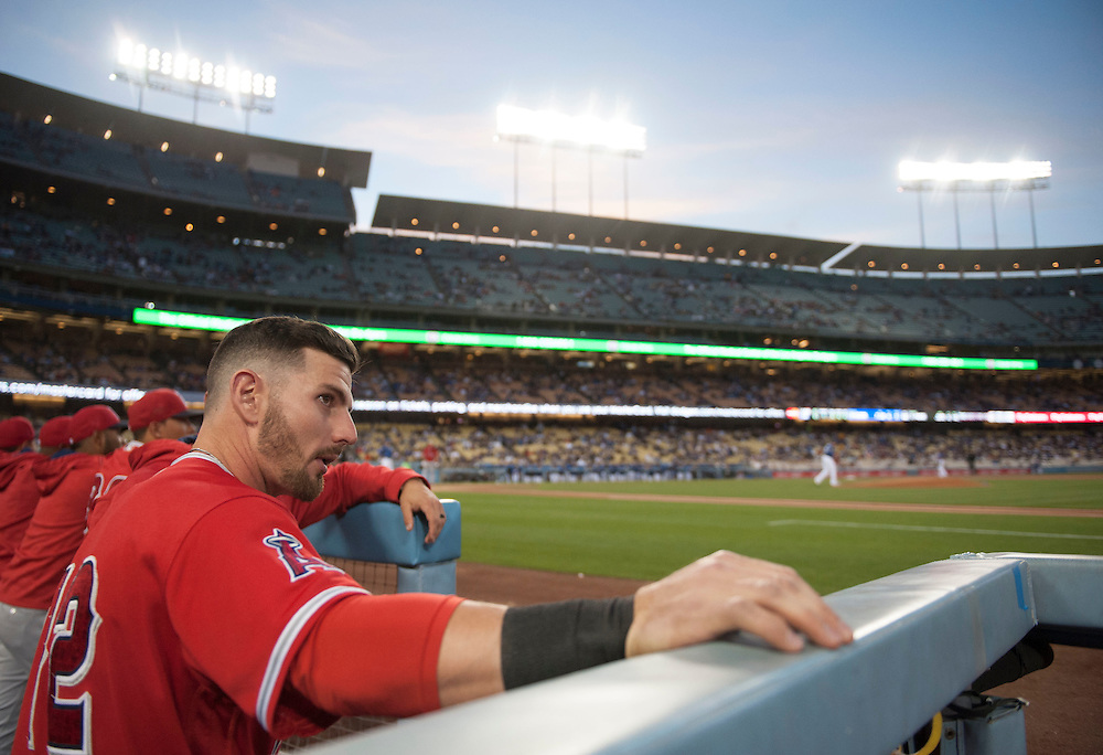 The Angels' Johnny Giavotella looks out from the dugout during the Angels' Freeway Series game against the Dodgers Thursday night at Dodger Stadium.<br /> <br /> ///ADDITIONAL INFO:   <br /> <br /> freeway.0401.kjs  ---  Photo by KEVIN SULLIVAN / Orange County Register  --  3/31/16<br /> <br /> The Los Angeles Angels take on the Los Angeles Dodgers at Dodger Stadium during the Freeway Series Thursday.<br /> <br /> <br />  3/31/16