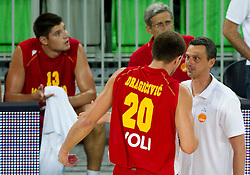 Vladimir Dragicevic of Montenegro and Dejan Radonjic coach of Montenegro during friendly basketball match between National teams of Slovenia and Montenegro of Adecco Ex-Yu Cup 2011 as part of exhibition games before European Championship Lithuania 2011, on August 7, 2011, in Arena Stozice, Ljubljana, Slovenia. Slovenia defeated Crna Gora 86-79. (Photo by Vid Ponikvar / Sportida)