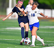 Althoff midfielder Natalie Cohn (left) battles Columbia forward Maddie Mauch for the ball. Althoff played Columbia in the sectional championship game at Althoff High School in Belleville, IL on Friday June 11, 2021. <br /> Tim Vizer/Special to STLhighschoolsports.com.