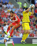 Gareth Bale of Wales puts pressure on Israel goalkeeper Ofir Marciano. Euro 2016 qualifying match, Wales v Israel at the Cardiff city stadium in Cardiff, South Wales on Sunday 6th Sept 2015.  pic by Andrew Orchard, Andrew Orchard sports photography.