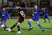 AFC Wimbledon attacker Egli Kaja (21) and AFC Wimbledon Jack Rudoni (12) battles for possession during the Pre-Season Friendly match between AFC Wimbledon and Crystal Palace at the Cherry Red Records Stadium, Kingston, England on 30 July 2019.