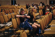 "Megan Cameron, 19, center left, and Mary Foster, 20, from Ferris State University, relax between speakers during day two of the Conservative Political Action Conference (CPAC) at the Gaylord National Resort & Convention Center in National Harbor, Md. ""To me, being conservative means to work hard and have pride that you put in your full share,"" said Cameron, who revitalized her school's College Republicans club."