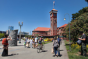 A group of tourists have thier picture taken in front of Union Station in Portland, OR. <br /> Image by Shauna Intelisano