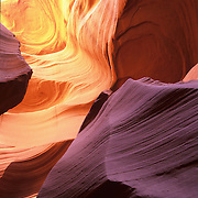 Light filters down into a unique slot canyon..With narrow rock walls, slot canyons are beautiful, but sometinmes dangerous places.
