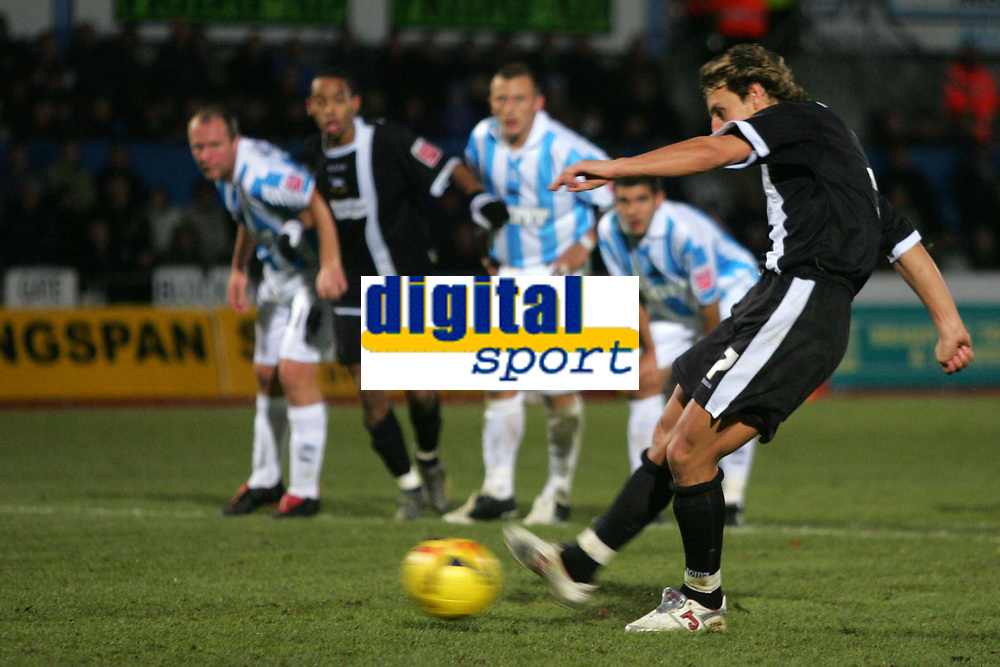 Photo: Frances Leader.<br />Brighton & Hove Albion v Derby County. Coca Cola Championship. 26/11/2005.<br />Derby's Tommy Smith (R) takes a penalty kick at goal which he misses after Brighton's Gary Hart fouled Derby's Marc Edworthy.
