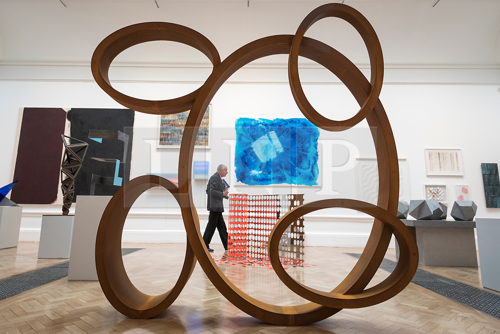 """© Licensed to London News Pictures. 05/06/2018. LONDON, UK. A sculpture called """"Square Dance"""" by Nigel Hall RA at a preview of the 250th Summer Exhibition at the Royal Academy of Arts in Piccadilly, which has been co-ordinated by Grayson Perry RA this year.  Running concurrently, is The Great Spectacle, featuring highlights from the past 250 years.  Both shows run 12 June to 19 August 2018.  Photo credit: Stephen Chung/LNP"""