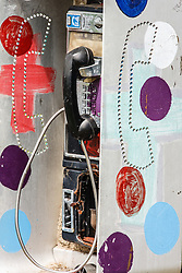 Painted phone booth. Heidelberg Project, Detroit, Michigan.  The Heidelberg Project is a grass roots project started by artist Tyree Guyton that uses art to help revitalize the embattled neighborhood.  Each year, over 275,000 people visit the project .  For more information, go to www.heidelberg.org